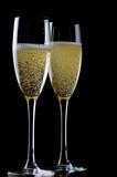 Two glasses champagne on black closeup