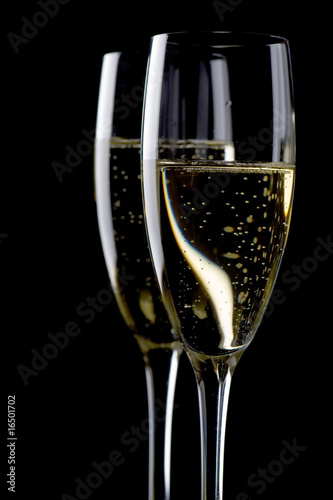 Two glasses champagne on black close up