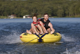 Tubing fun on a lake