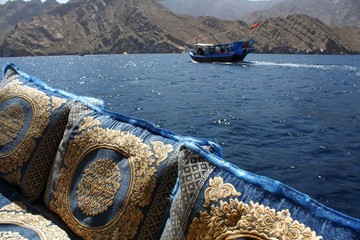embroidered cushions and cruise in oman waters