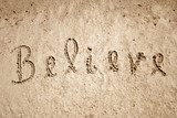 Believe handwritten in sand for natural poster