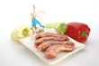 raw turkey neck with vegetables on a plate