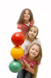 Girls with colored balls imitating traffic lights poster