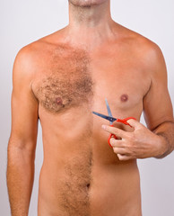 half unshaved man with scissors