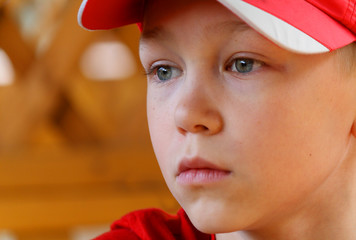 The boy watches in a cap with interest on representation