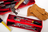 A Red Toolbox with miscellaneous tools poster