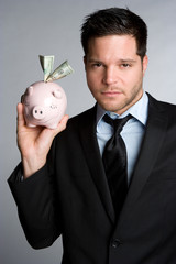 Man Holding Piggy Bank