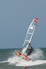 windsurf jumping over wawe