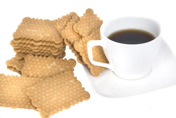 close up of a cup of coffee with cookies