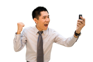 Asian business male happy over results showed on phone