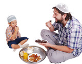 Young muslim and son with prepared food for iftar in Ramadan poster