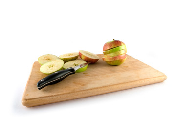 sliced apples by knife isolated on white background