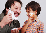 Father is teaching his boy how to shave poster