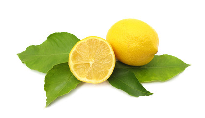 Fresh lemons with green leaves