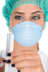 female doctor with operation dress and syringe