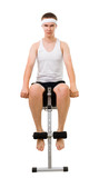 Young man do fitness, sitting on bench for abdomen muscles poster