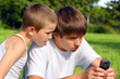 teenager and kid with mobile phone
