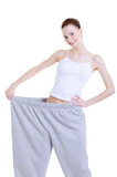 slender young pretty girl on the large trousers after diet poster