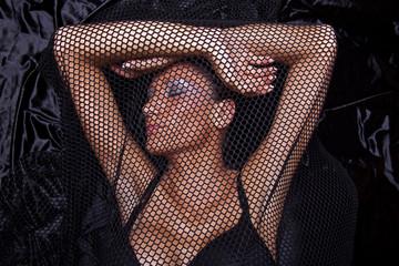 Woman Traped In Black Fishnet