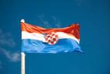 Croatian flag against blue sky poster