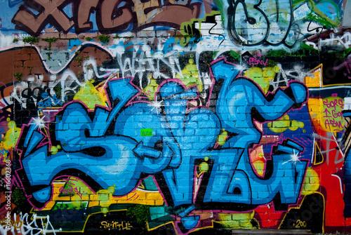 Leinwandbild Motiv Graffiti detail on the textured brick wall