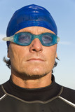 Macho looking male swimmer wearing swimming cap and goggles poster