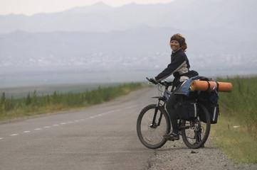 Woman biker on a road