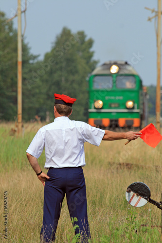 Railway traffic controller giving a signals to the train crew - 16620745