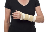 Woman with arm in bandage and splint