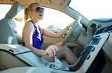 blonde woman driving poster