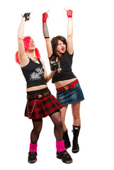 Portrait of two punk girls isolated over white in studio