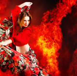 Fototapety Hot woman dancer. Fire burning in background