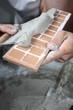 Préparation de plinthes (carrelage)