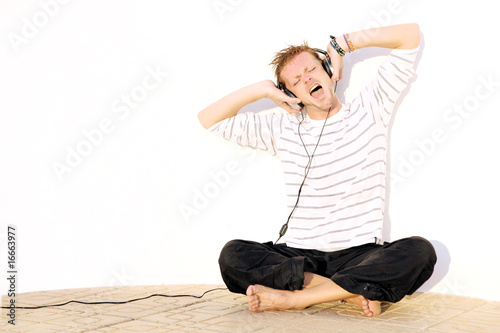 man singing with headphones