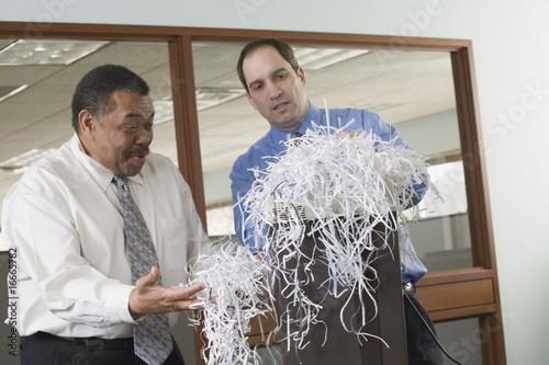 Businessmen with paper shreds
