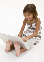 A young girl working on her laptop