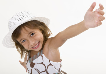 A Cute Young Girl Wearing a Hat