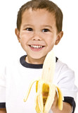 A young boy holds a fresh yellow banana.