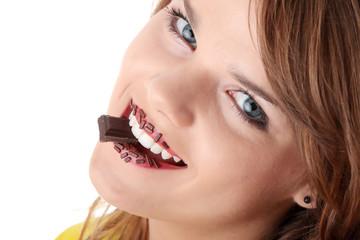 Teen girl eating chocolate
