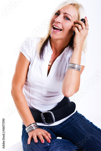 Successful and happy woman with a mobile