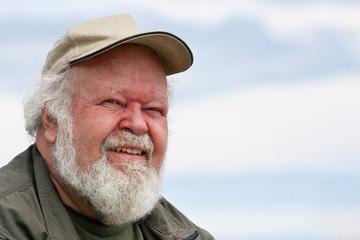 Portrait of a senior male against sky