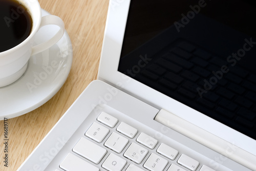 White laptop and coffee cup