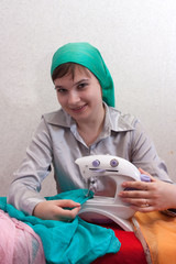 woman works at a sewing machine