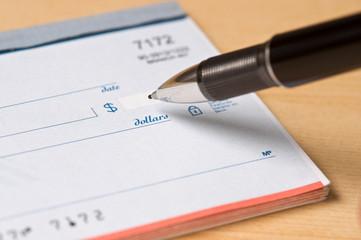 Pen writing a check