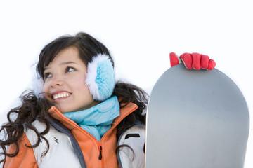 Laughing beautiful girl snowboarder