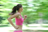 Fototapety Young woman running outdoor - motion blurr