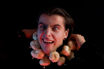 Funny vampire suffocated from being choked by garlic