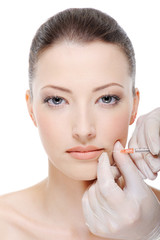 Injection of botox in the female lips