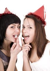 Two girl  on birthday eat chocolate cake.