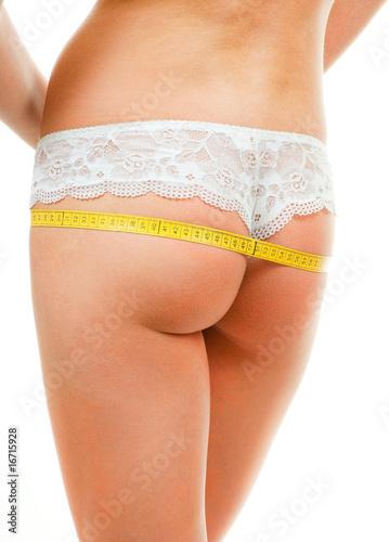 Woman measuring her ass